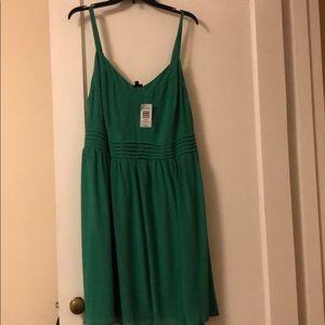 Green polyester dress.  Never worn.  Torrid size 3